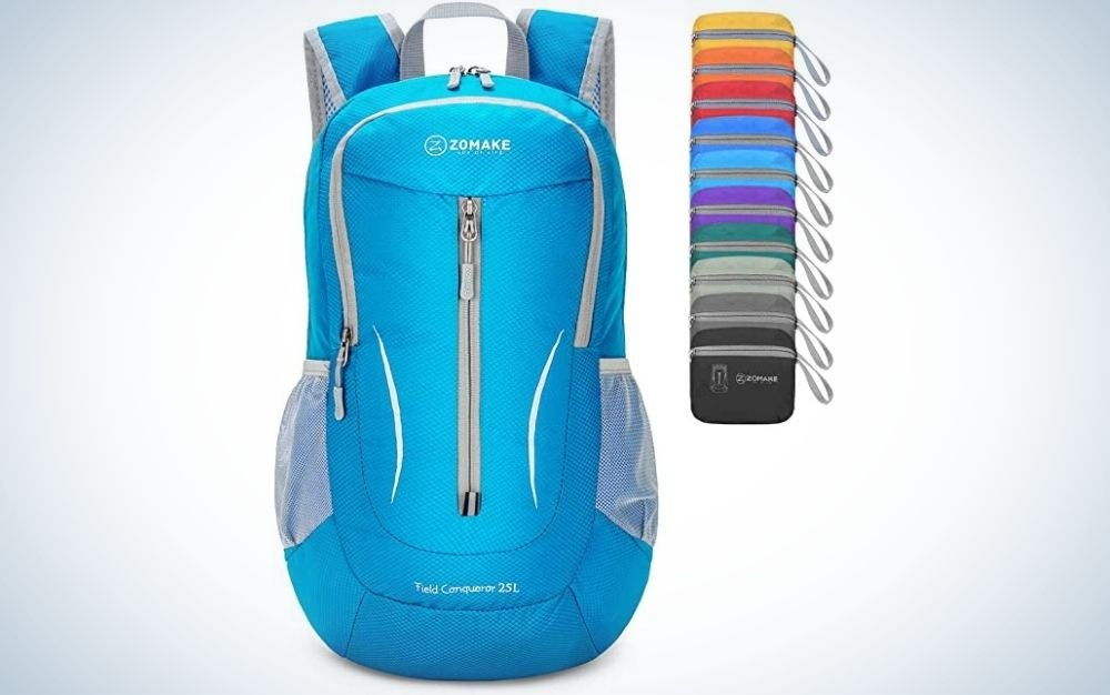 A hiking backpack with a pronounced blue color and a series of colors lined up next to each other.