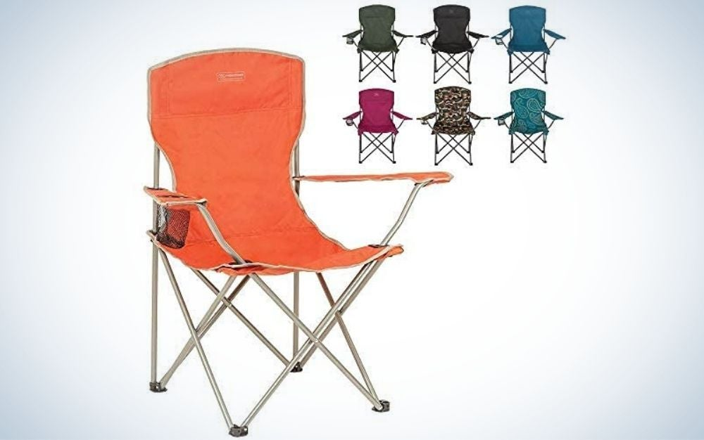 A pink chair with a closed black bag and six other colorful chairs into them.