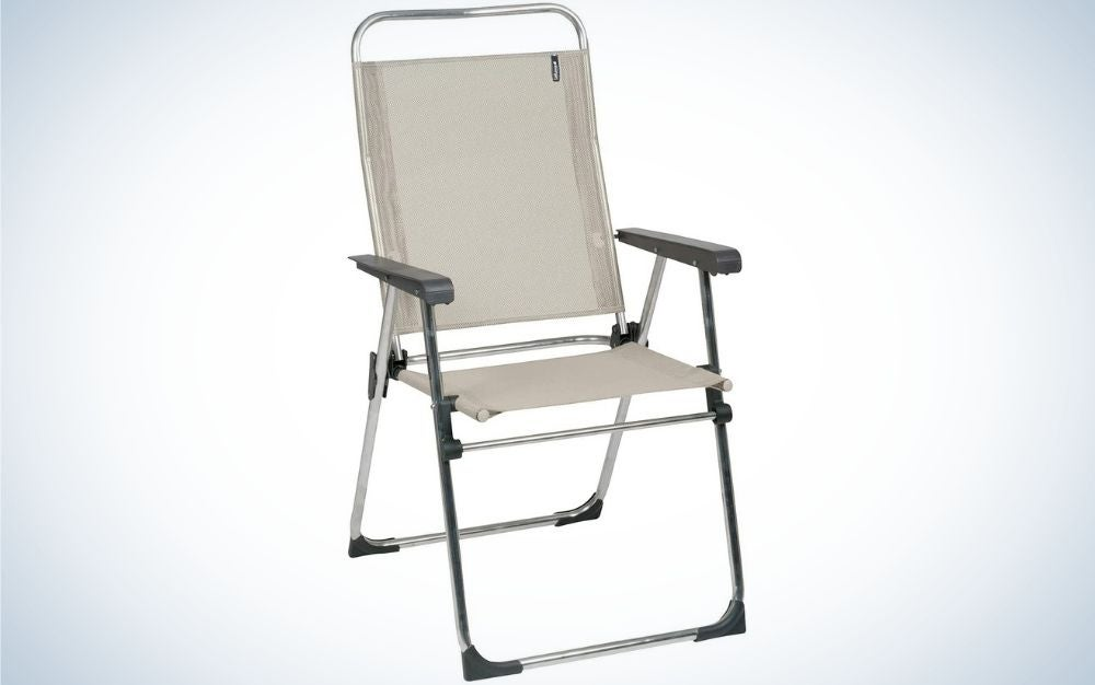 A grey chair with a metal hand and two legs of the chair.