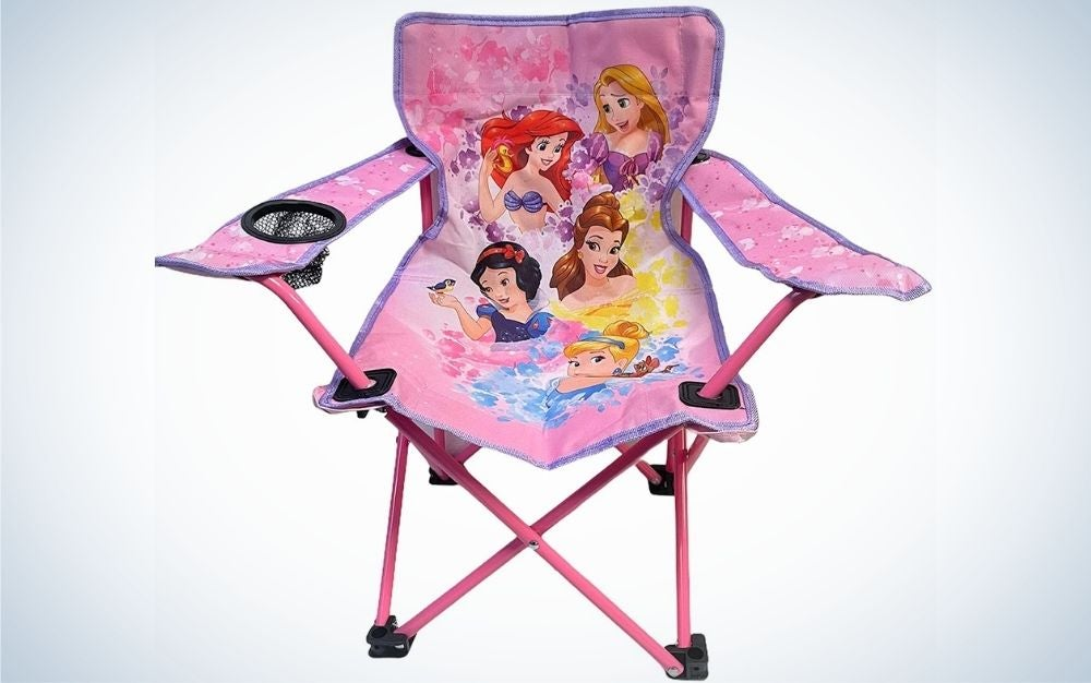 A small pink chair with some anime pictures for young children.