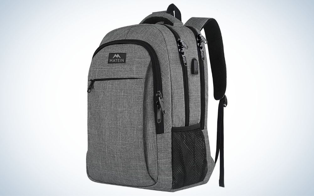 Gray backpack with USB charging port with multiple zipped pockets