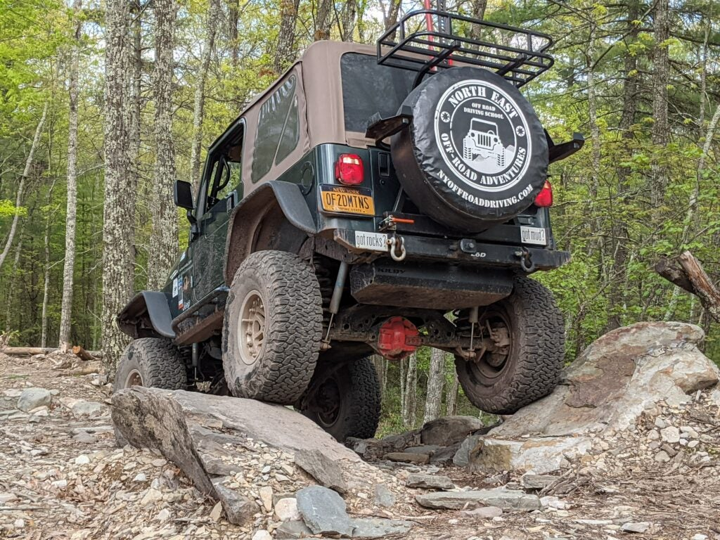 jeep off-road driving over boulders