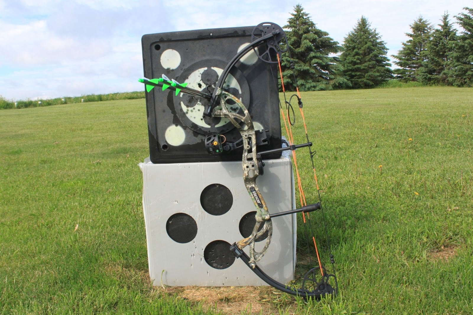 Bear Cruzer G2 hunting bow leaning against a target