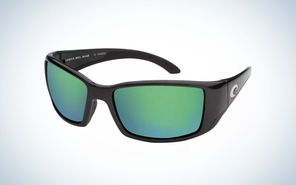 A pair of sunglasses with a black frame and structure and two lenses in bright neon blue.