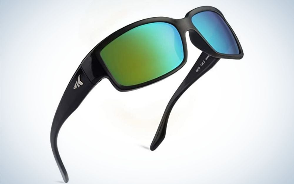 A pair of sunglasses with a black frame and structure and two lenses in bright colorful shades.