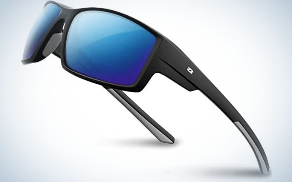 A pair of sunglasses with a black and grey frame and structure and two lenses in bright neon blue.