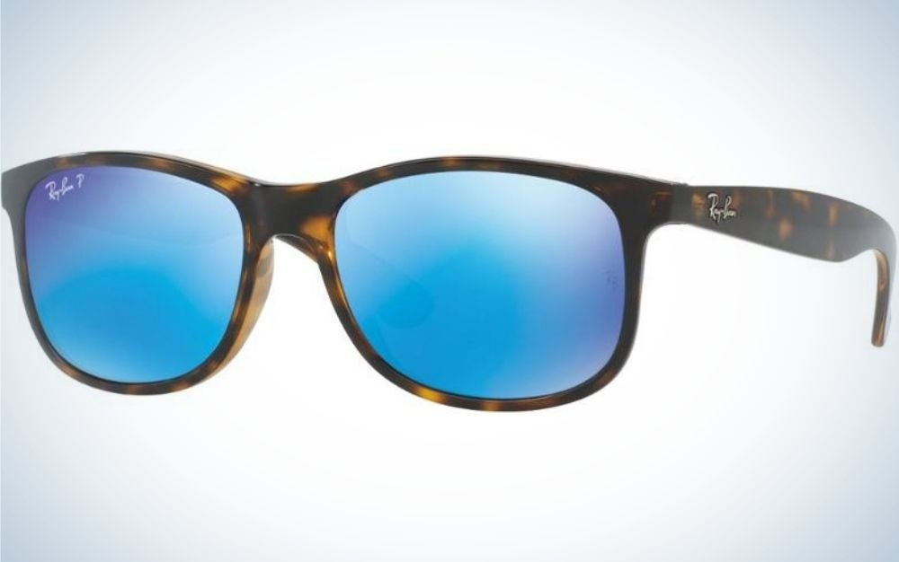A pair of simple glasses with a brown and black skeleton structure and also neon light blue lenses.