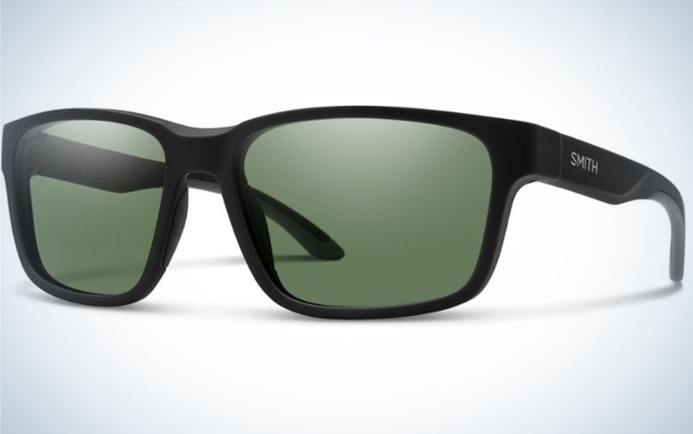 A pair of simple glasses with a black skeleton structure and also light black lenses with name f brand into the skeleton.