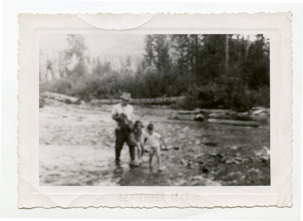 Norman Maclean fishes with his children.