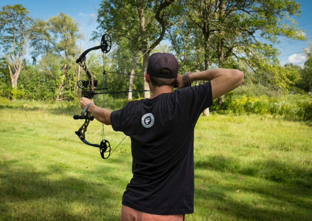 Archer at full draw with a compound bow