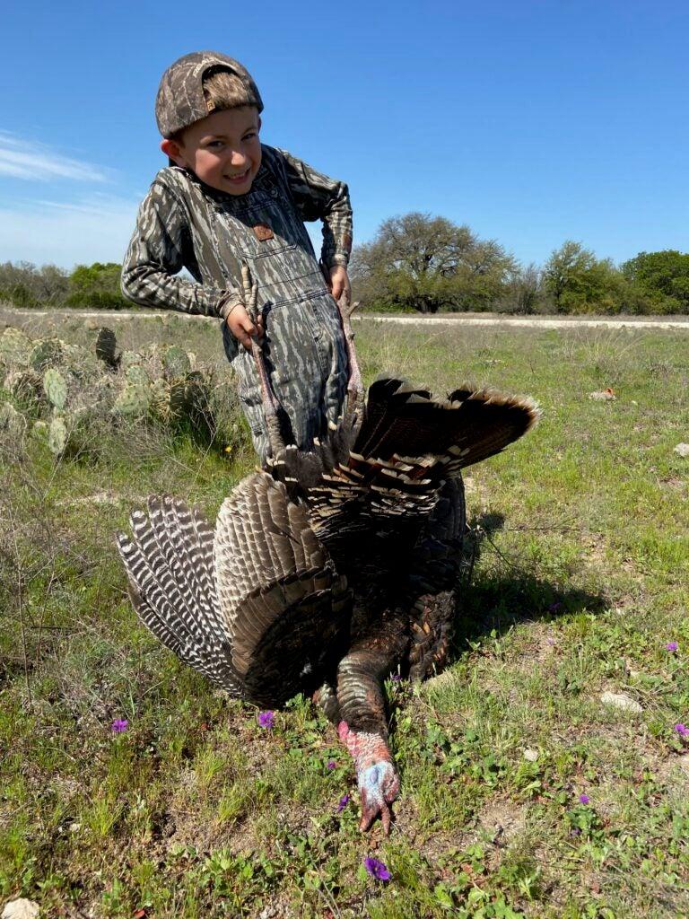 Anse Brantley with a wild turkey.