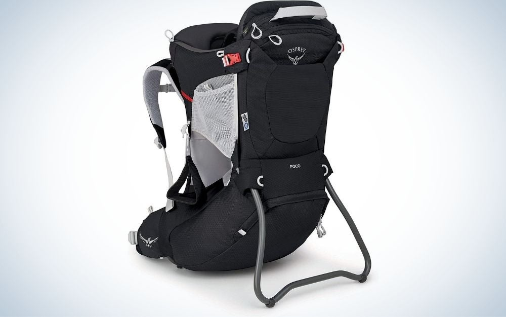 A black backpack with two spacious side pockets with a white net and a space in the middle of the bag that serves as a holder for children.