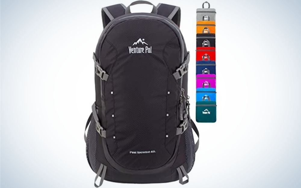 A large black backpack with some light gray stripes on the side and the colors of the bag that are able to be on the side.