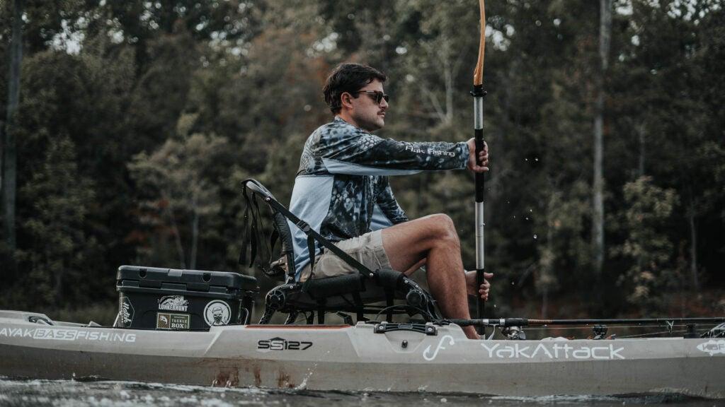Fisherman paddling in a Bonafide SS127 kayak