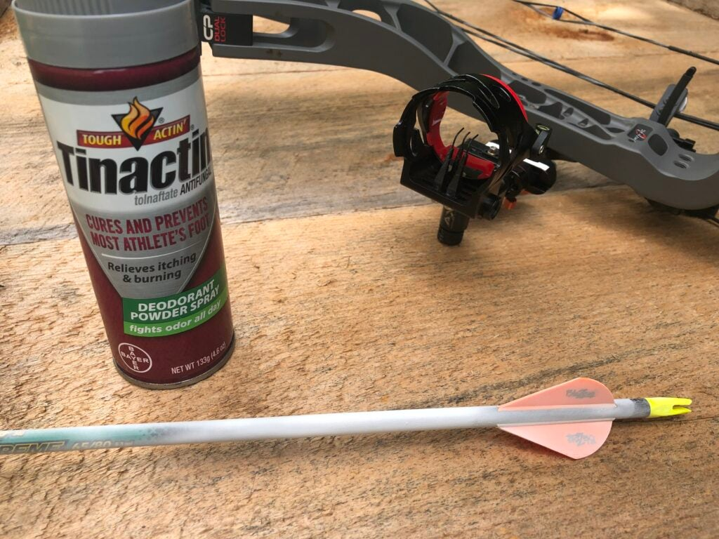 How to tune a compound bow step 4: Use foot powder for bow tuning.