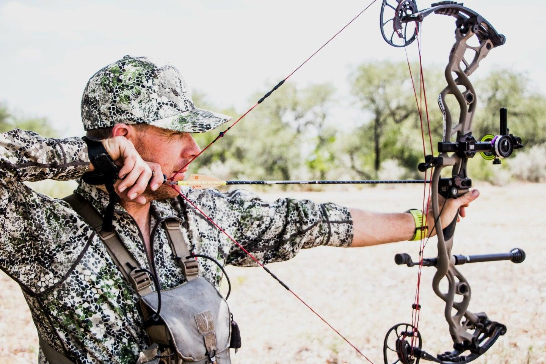 Jace Bauserman shooting a bow