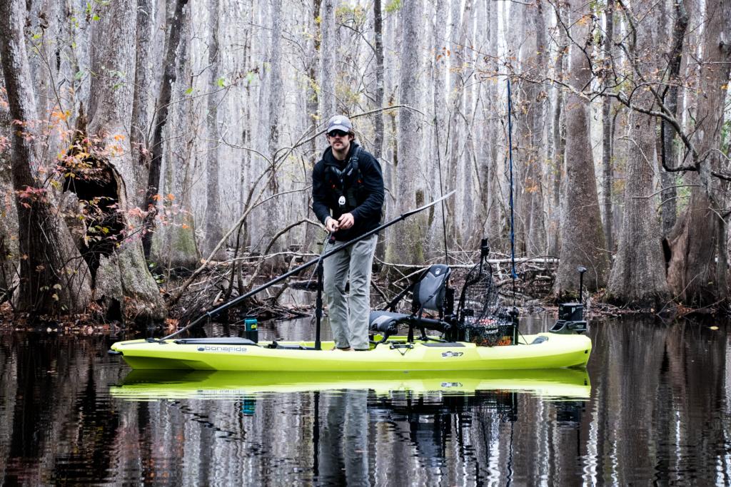 Fisherman casting on a Bonafide SS127 kayak