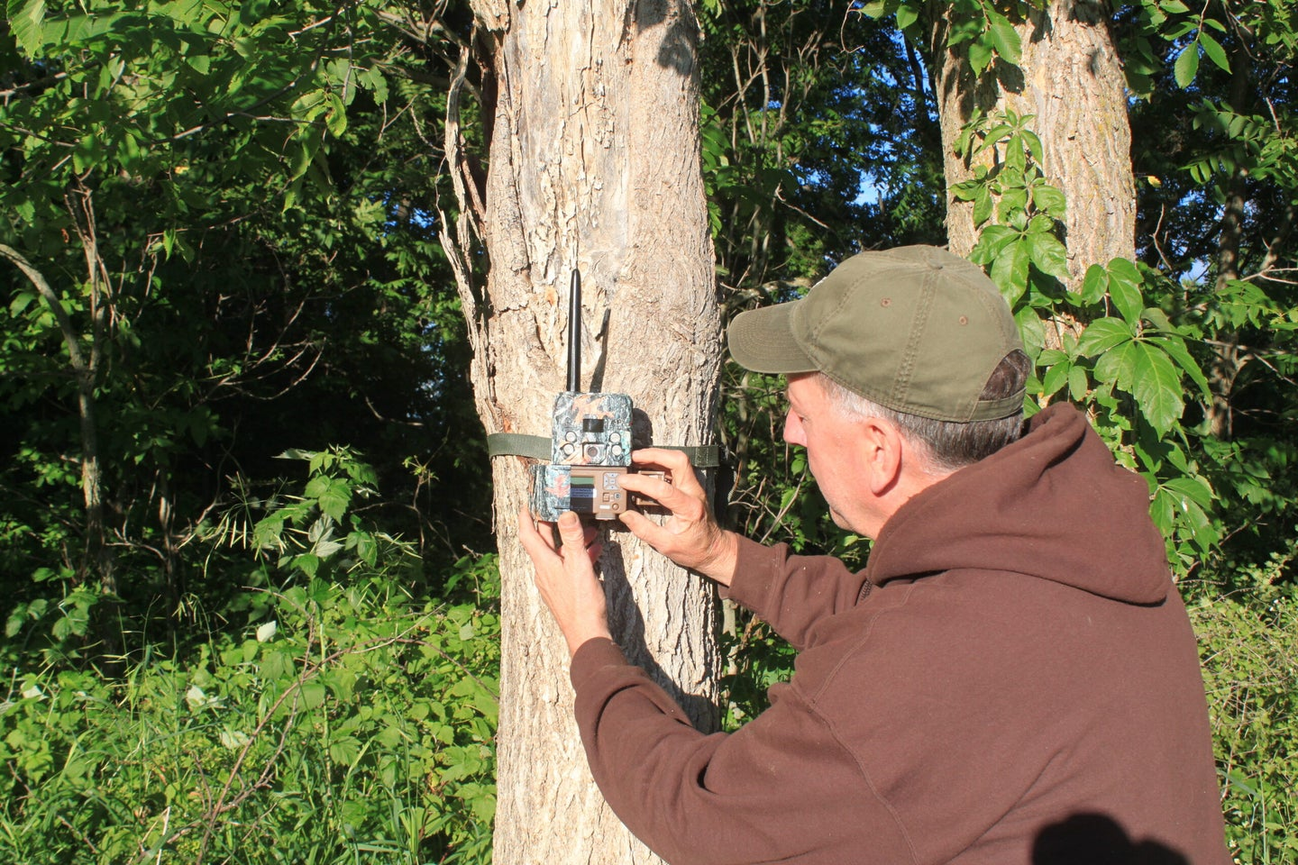 guy setting up trail cam