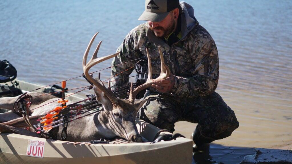 Hunter using NuCanoe Frontier 12 to transport deer