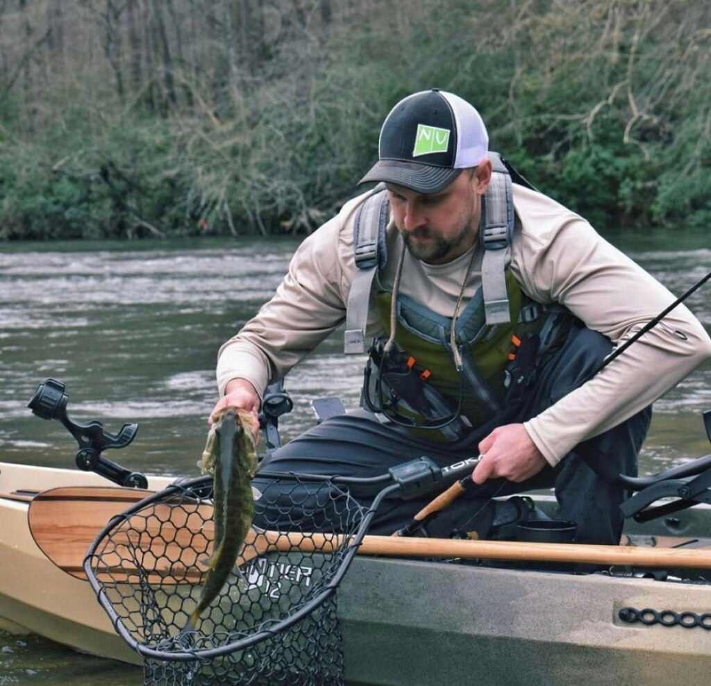 Fisherman on NuCanoe Frontier 12 with a bass