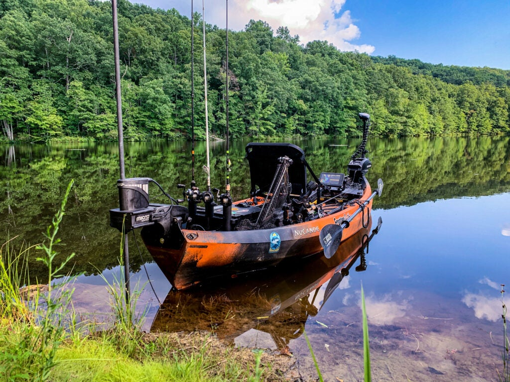 The NuCanoe fishing kayak with rods and trolling motor