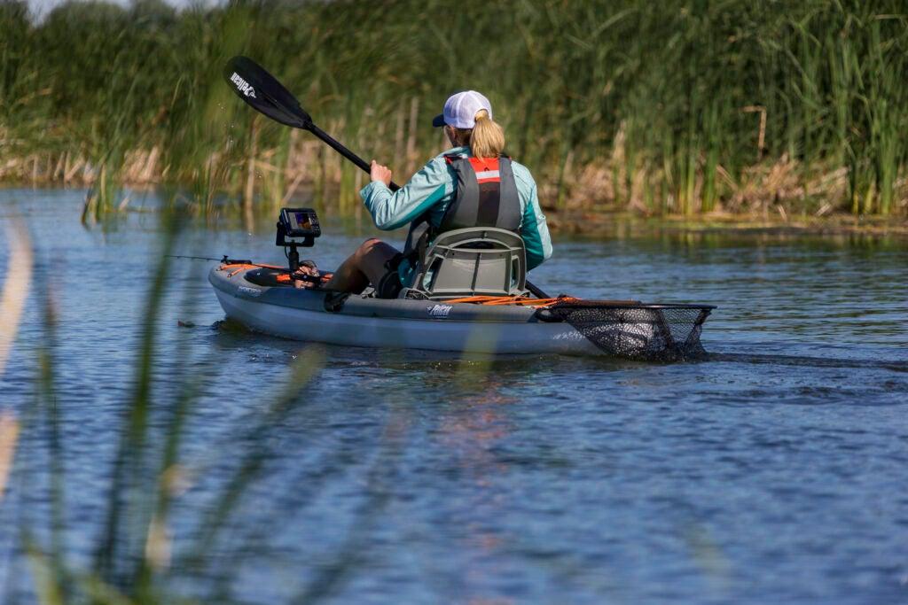 Women paddling kayak with fish finder