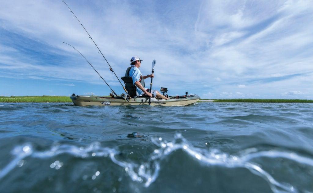Man paddling kayak with fish finder