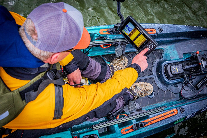 Kayaker using fish finder