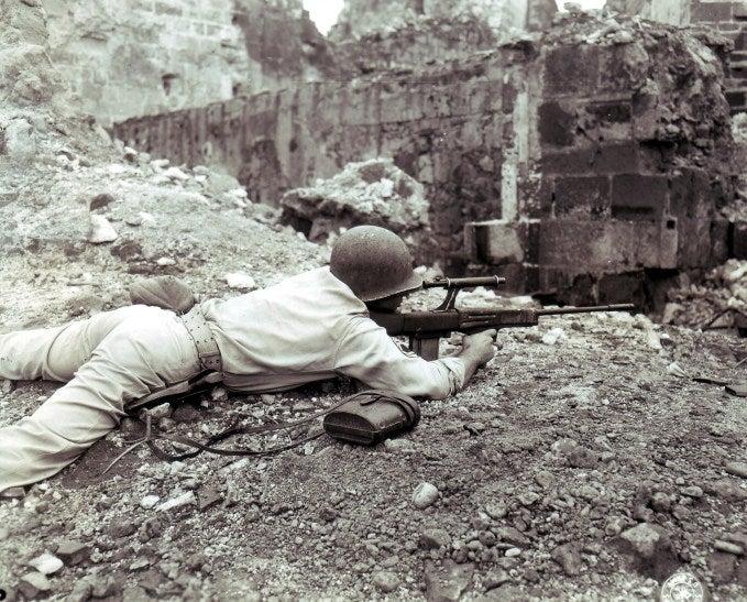 Soldier firing a prototype gun.