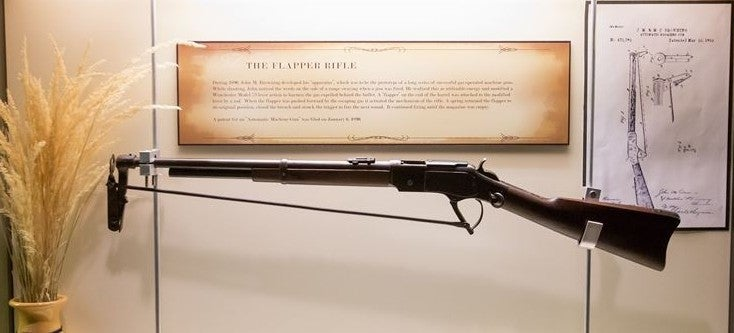 An early prototype of a gas-operated gun in a display case.