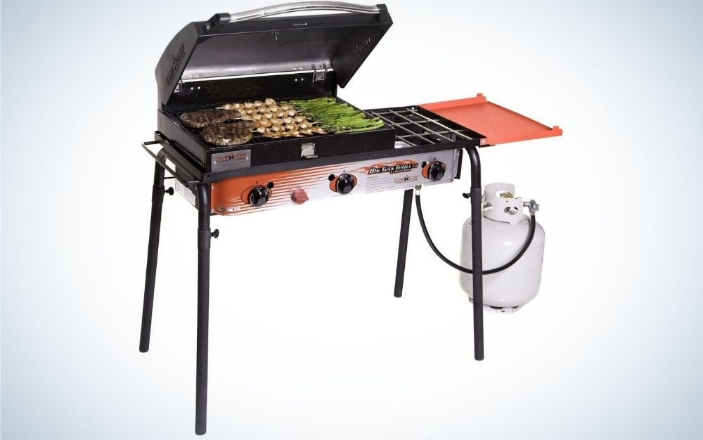 Camp Chef grill with burgers, chicken, and vegetables cooking
