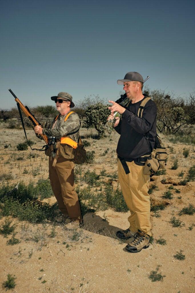 two hunters hunting jackrabbits