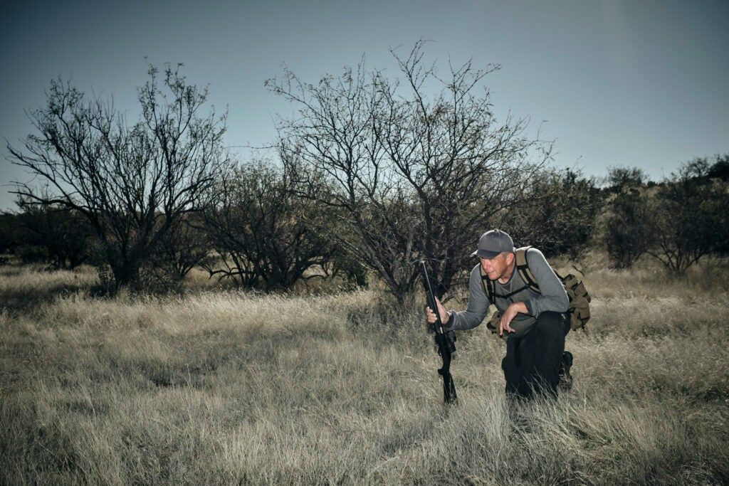 a rabbit hunter looks for jackrabbits in the southwest