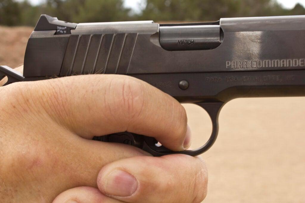 Trigger control with a handgun
