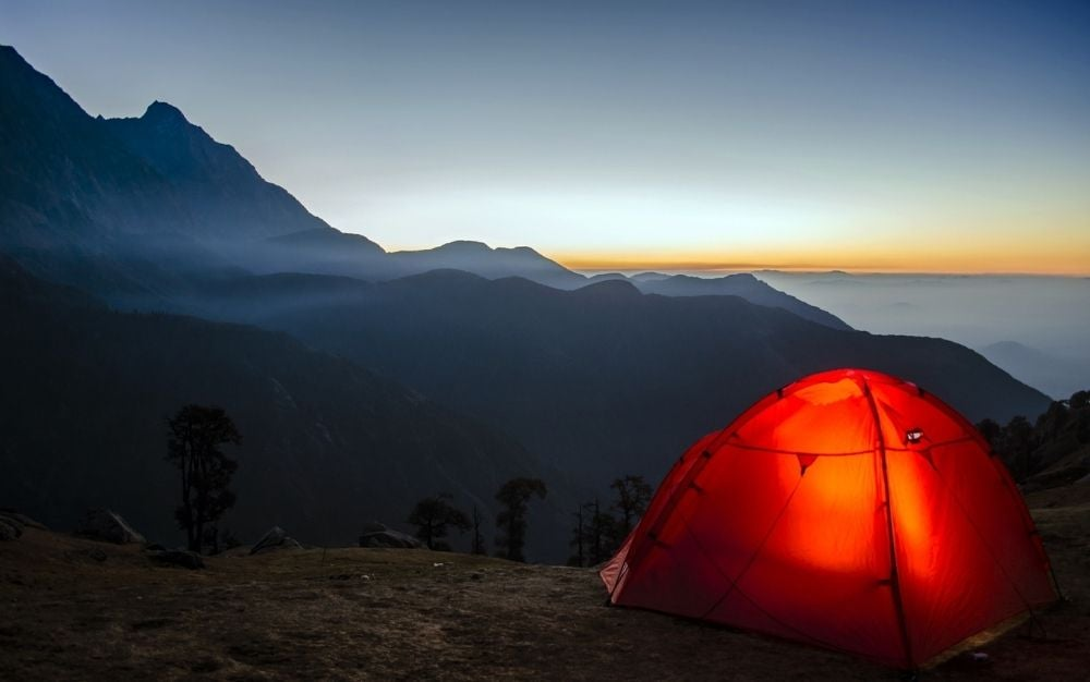 A tent which is light and between the mountains at a high altitude.
