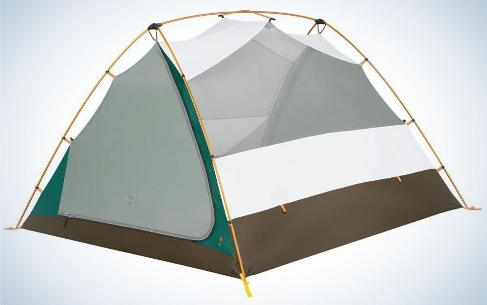 A small tent with a space from above, which is connected and shaped like a roof from above, white in color and with a thick brown and green stripe from below, and caught with orange rope by one corner of the tent in the other.