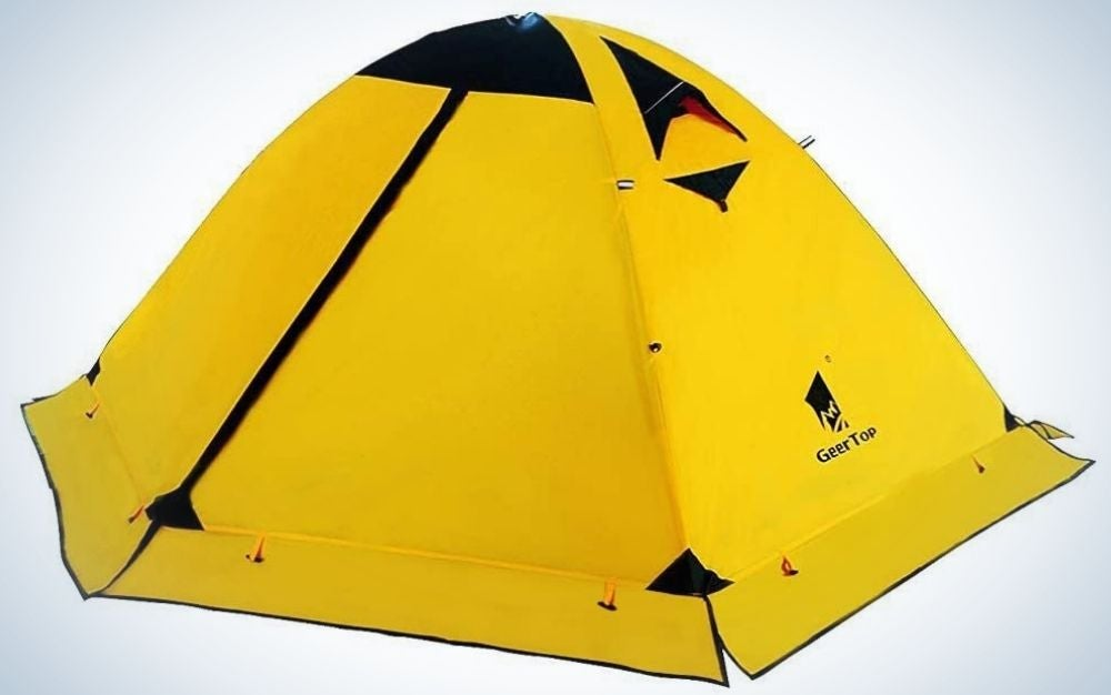 A camping tent all closed and with a strong yellow color and some small black parts.