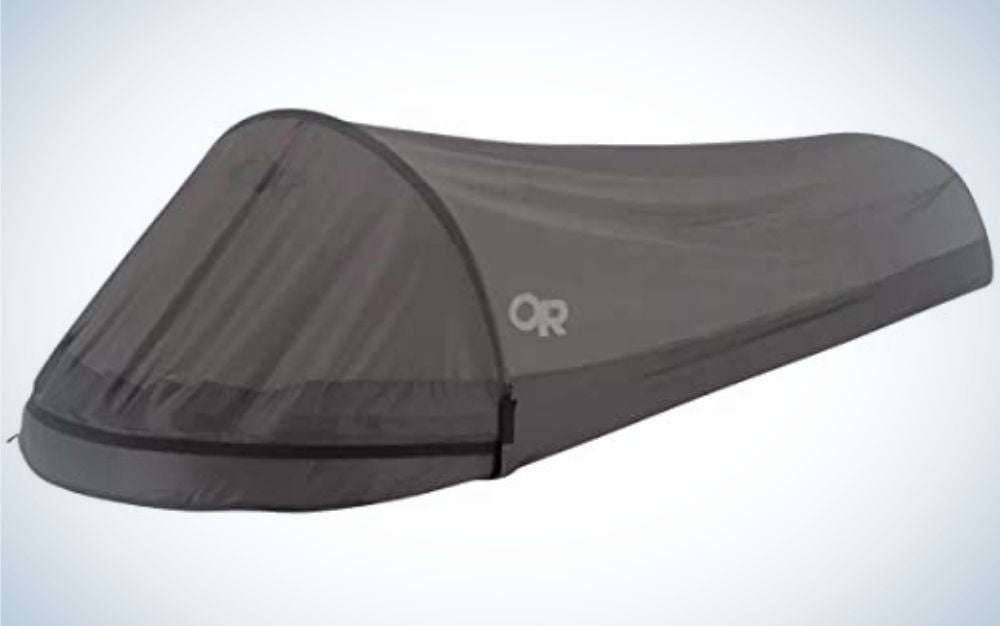 A tent for camping and winds all in the form of a single bed.