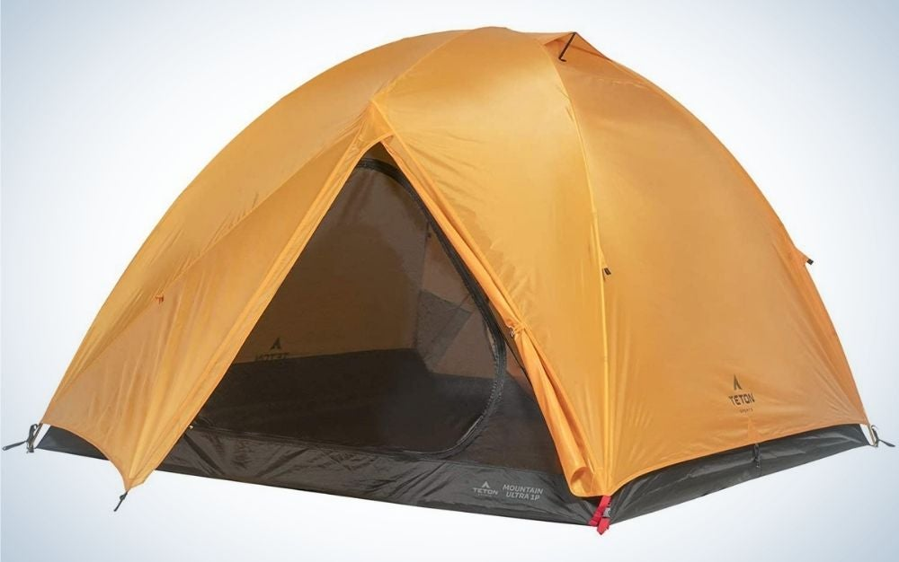 A bright brick color tent from above, as well as with the front part open and the bottom part black support.