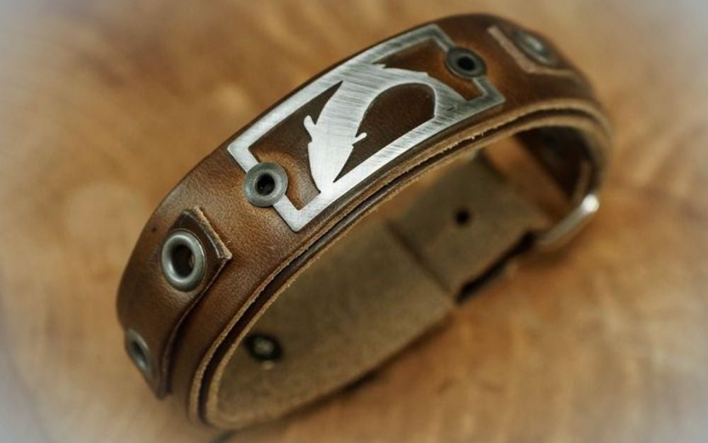 The best fishing gifts include metal badge mounted on leather cuff fishing bracelet