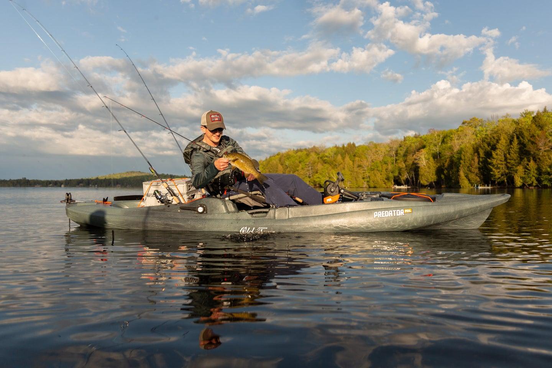 fisherman on old town predator kayak