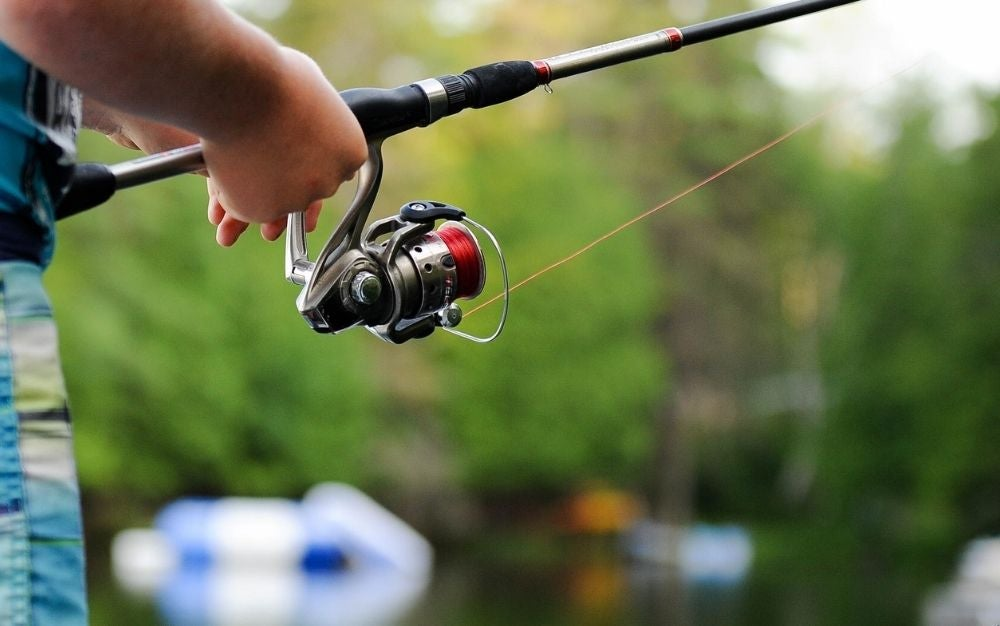 A spinning reel in use.