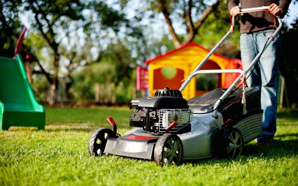 Person using a lawn mower