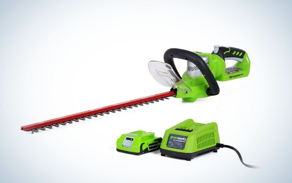 Green, cordless hedge trimmer with battery and charger