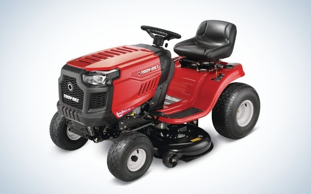 Red and black riding lawn tractor with mow in reverse