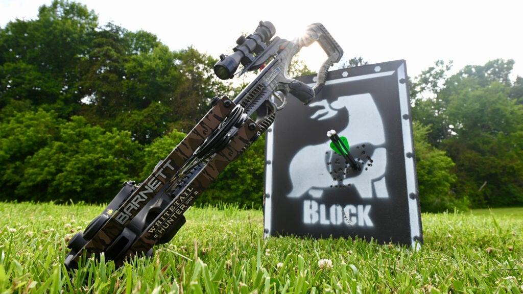 Barnett crossbow leaning on target