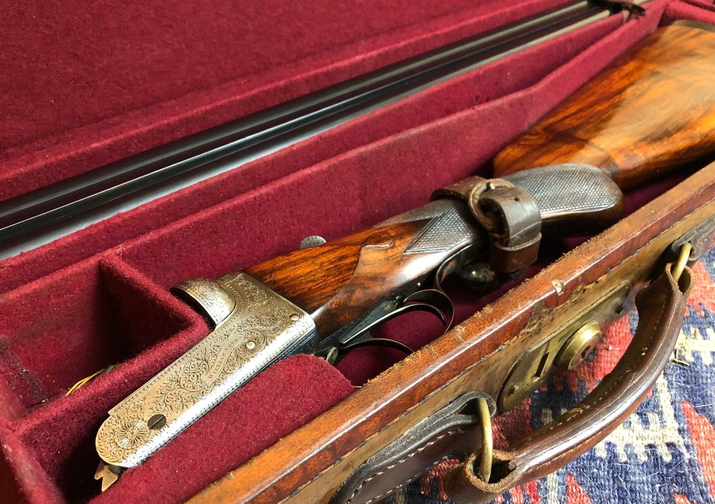 12-gauge classic upland shotgun in a case