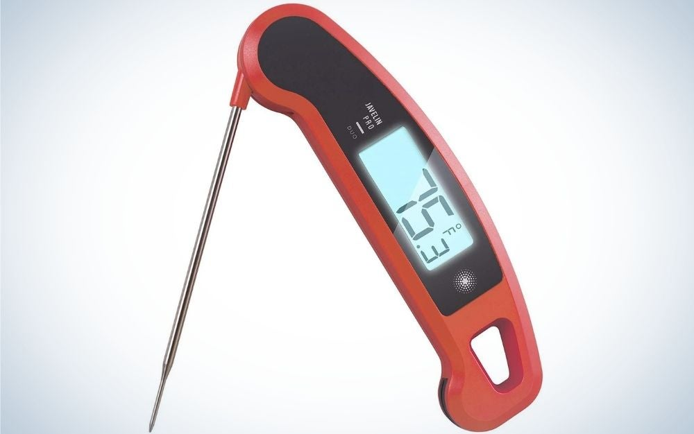A meat thermometer with a thin silver metal tail, as well as a number indicator with a red cap with a gray screen.
