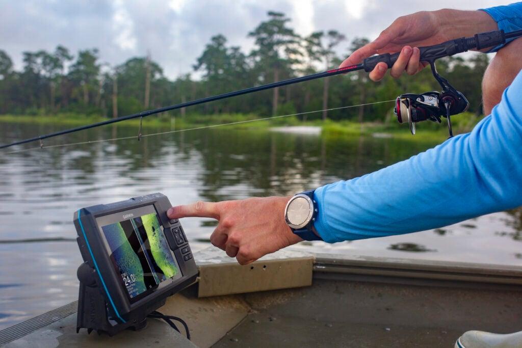 angler using Garmin fish finder