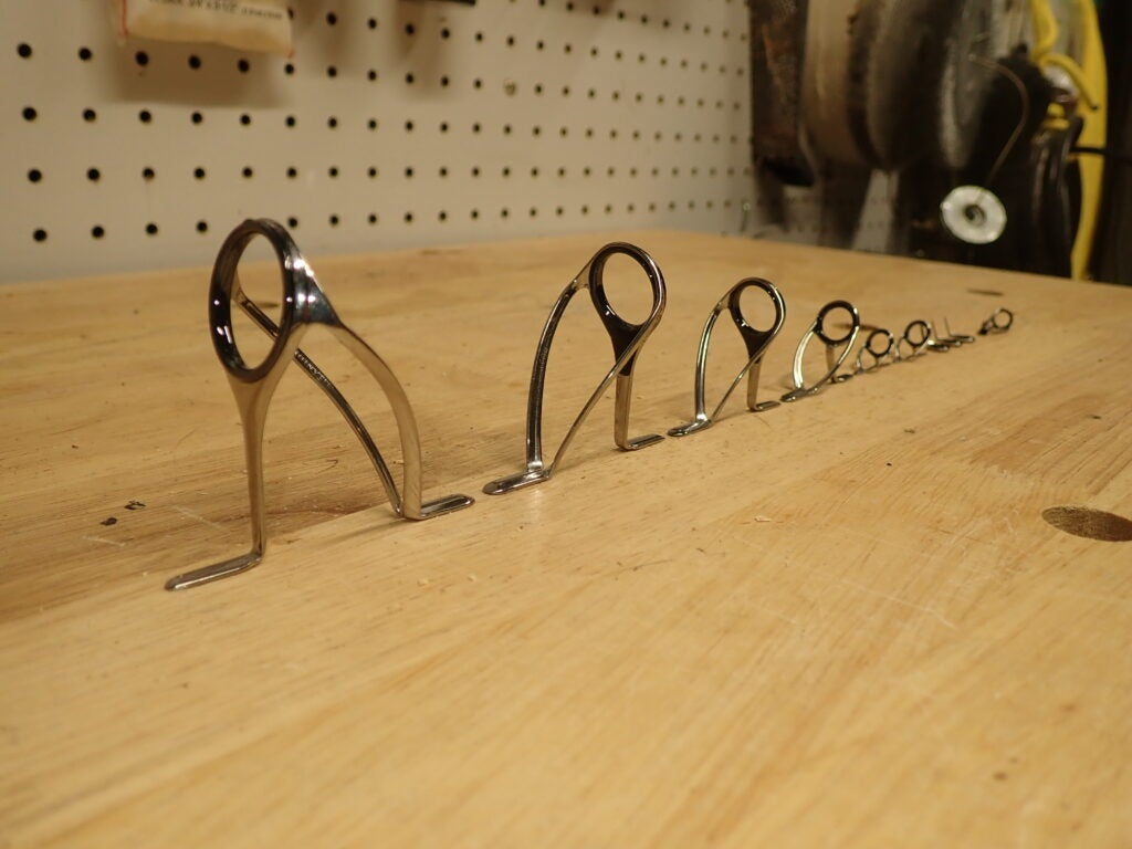Fishing rod guides on a table.